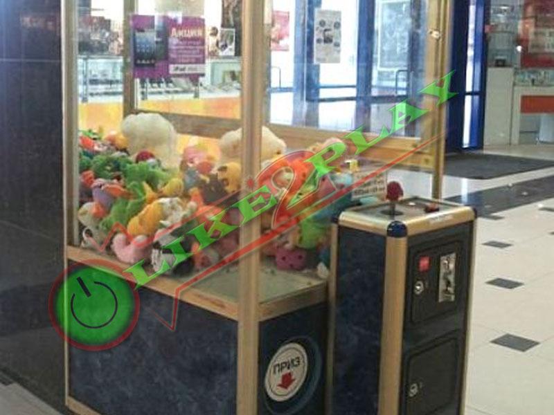 Автомат с игрушками, приз